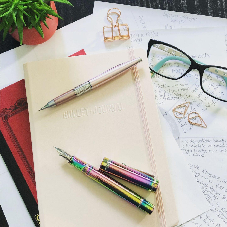 Red Apica C11 notebook, Bullet Journal Edition 2, Pink Pentel Sharp Kerry mechanical pencil, Conklin Durgraph fountain pen Rainbow